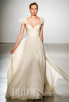 A floaty champagne-colored @amsale wedding dress with fluttery cap sleeves  | Brides.com