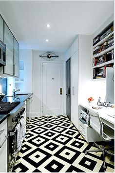The pattern on this black + white painted floor is very David Hicks-like.
