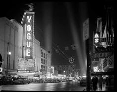 Vogue Theatre at night with spotlights VPL Accession Number: 80284 Date: November 1958 Photographer / Studio: Croton Studio Content: Vogue Theatre exterior. Crowds for CKNW Orphans Fund premier of the Defiant Ones Granville Street, Day And Nite, Vancouver Bc Canada, Neon Noir, City Vibe, Most Haunted, Haunted Places, Public
