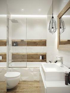 Los baños blancos son la manera más sencilla de acertar a la hora de decorar o elegir el color del baño, ya que, además de hacerlos más luminosos y visualmente más grandes, también adquieren un aura atemporal, que podemos aprovechar con el paso de los años para ir renovando accesorios y otras pequeñas cositas, y lucir un baño como nuevo por mucho que pase el tiempo, y, si el ambiente del baño resulta excesivamente frío, siempre podemos añadir materiales como la madera o cálidos textiles, así…