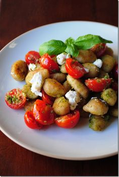 crispy pesto gnocchi with tomatoes and goat cheese...i'll have to figure out what to  use instead of pesto