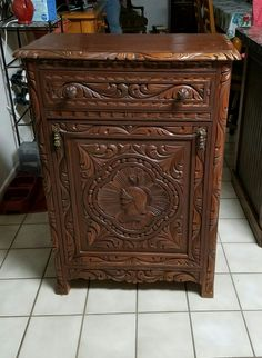 Vintage Carved wood Liquor Cabinet.   Found at estate sale.  Would love to find out more about it.