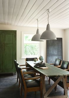 lovely rustic trestle table and pendant lights over dining