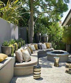 Modern use of concrete setting walls & gravel patio flooring. Love it!