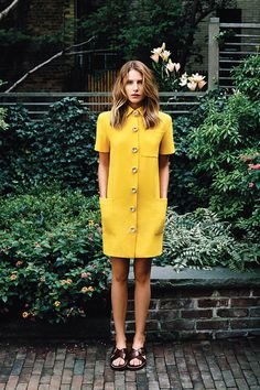 Dree Hemingway in a yellow dress with big buttons - Big dreams. Good music. Expensive taste.