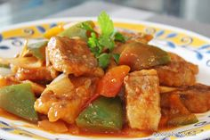 Sweet And Sour Fish Fillet 糖醋鱼片 Delicious Chinese dish consists of crispy fried fish slices, are stir-fried in sweet and sour sauce, with veggies such as green pepper (capsicum), onion and tomato. 香酥內軟的魚片,淋上甜酸酱汁提味,酸酸甜甜,開胃好下飯的佳餚 !