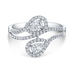 FM33114-18W 18K WHITE GOLD FOREVERMARK® DIAMOND BAND Two pear-shaped Forevermark® diamonds are the centerpiece of this diamond band. Metal 18k White Gold Metal Weight 2.92 grams Center Shape Pear Total Center Size 0.50ct Number Of Stones 65 Side Stone Type Round white diamonds Approx. Ctw. 0.33cts.