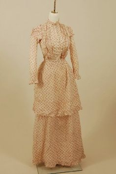 white cotton calico dress with a red floral pattern, ca 1890. Kentucky Historical Society