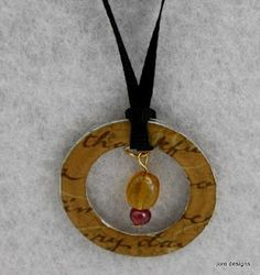 Glossy washer necklace using modge podge and scrapbook paper with glossy glaze