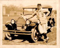 Old photo of Detroit Tiger, Ty Cobb wearing a  Shawl Sweater.....love the sweater and car!!!!