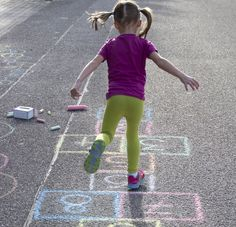Off-Skate Games for Kids: Playing hopscotch is a great way to develop balance skills.
