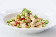 Chicken Daikon Salad: edamame beans, red peppers, and green onions in a plum soy vinaigrette
