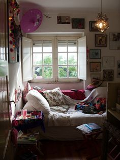 Like different things about this room. The cozy window hangout, the pictures on the wall, and the light fixture