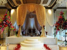 Golden mandap design with light touches of orchids. #wedding #mandap #flowers #decorations #indian