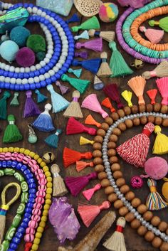 A world of jewelry making supplies is at your fingertips at ShopWomanShopsWorld.com.  Tassels, Pom Poms, Beads, and so much more. Come Live (color)FULLY™ with us.