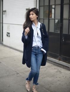 Wearing a chunky knit cardi is the perfect way to dress down a smart casual outfit and make it appropriate for every day wear! This navy blue number looks super cute paired with denim jeans and an open button down shirt. Via Van Le. Cardigan/Jeans: Moda Operandi, Shirt: Rag & Bone.