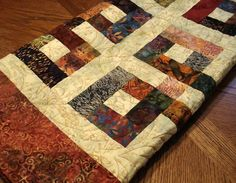 Waste Knot batik quilt by nparkinson on Etsy interesting pattern that looks easy