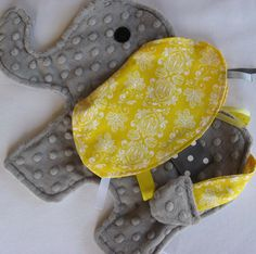 Simply too cute!  Sunny Yellow Elephant Sensory Security Lovey by IcingOnTheCupcake. $25.00, via Etsy.