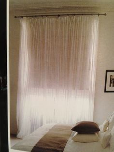 Main bedroom, sheer curtain with roman blind and iron rod (The New Curtain Book by Stephanie Hoppen)
