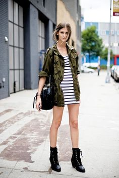 15 Ways To Wear A Green Army Jacket: Daiane Conterato in a striped dress & lace up boots #style #fashion #streetstyle