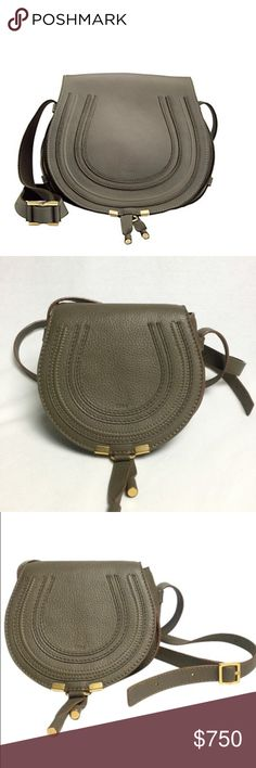 "Authentic Chloe bag A Chloe saddle bag styled in pebbled ""Baobab"" green calfskin leather with gold-tone hardware. This Chloe handbag features twill lining a main pocket with flap closure, 2 interior slip pockets and a crossbody strap with a21.7"" drop. Dimensions: 11.8"" x 9"" x 3.9"". Made in Italy. BRAND:Chloe SERIES:Marcie GENDER:Ladies MODEL:3S0905-161-B76 MADE IN:Italy STYLE:Shoulder Bag COLOR:Green MATERIAL:Leather MEASUREMENT:11.8"" x 9"" x 3.9"". Chloe Bags Crossbody Bags"