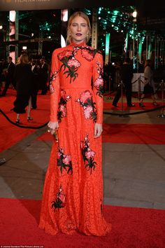 Did she fashion these from curtains? US Fashion model Dree Hemingway, 28, the great, great grandaughter of novelist Ernest, won the award for the most unique outfit, posing for the world's media in a floaty scarlet red Gucci number adorned with embroidered flowers. The outfit, which covered the model from neck to toe clashed with the red carpet