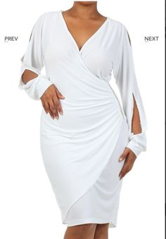 """Our """"Tonia"""" Wrap dress Trumps All of the drab wrap dress out there.  The chain detailing on the hip and spliced arm cut outs puts this dress in a league of her own!   **Ships 4/29!! Pre-Order Now to get yours!!!**"""