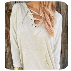 NEW LISTING! NWT Lace Up Long Sleeve Hoodie This is a nice lace up top! Medium weight! It is a pretty shade is cream! Super comfortable to! Boutique Tops Sweatshirts & Hoodies