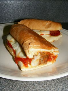 Meatball Subs ----- homemade meatballs in your favorite marinara sauce and Provolone cheese make this a fast and easy meal that everyone will love. My sandwich is shown.