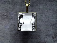 Fornasetti faces glass dome necklace  pendant by ShoShanaArt, $17.00