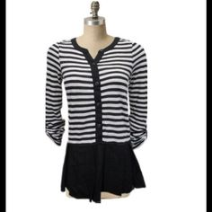 Black & White Striped Tunic Beautiful versatile black & white striped blouse. Henley style buttons to the waist. Drop waist with black peplum hem. Long roll-up sleeves with button tabs. Body: 52% cotton & 48% polyester. Trim: 55% linen & 45% rayon. Anthropologie Tops Tunics