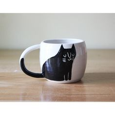 Black and White Double Espresso Cup with Happy Cat handmade pottery... ($27) via Polyvore featuring home, home decor, black cat home decor, cat home decor, handmade home decor, black home decor and black and white home decor