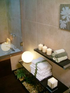Use low floating shelves to display candles and towels next to your bathtub. These elements can help create a spa-like retreat within your bathroom.