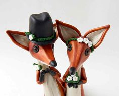 The fox cake toppers I wanted sold the day before I tried to buy them, so I had these fox cake toppers custom made by the artist.  These are the actual foxes that will perch atop our wedding key lime pie.