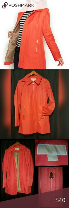 """Authenic! MICHAEL KORS Raincoat ☔ Cotton/Polyester  Machine washable  Pointed collar, with removable button hood MK logo inside lining Water resistant  Color: Coral  Hits at low hip approx. 31 inches   #WornOnce  #GreatCondition    Prices """"ALWAYS """" negotiable,  Make me an offer  MICHAEL Michael Kors Jackets & Coats Trench Coats"""