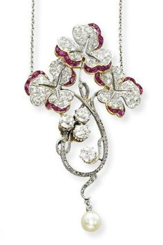 AN ART NOUVEAU RUBY, DIAMOND AND PEARL PENDANT Of floral spray design, the old-cut diamond and French-cut ruby leaves on a rose-cut diamond stem with old-cut diamond detail and pearl drop, to the removable chain fitting, mounted in platinum and 18k gold, circa 1900, pendant length 7.1 cm long, with French assay marks  #ArtNouveauRuby
