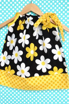 So cute yellow, black and white polka dot and flower toddler dress!