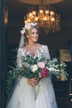 Bride with handtied bouquet and floral crown   Credit: Shanna Jones