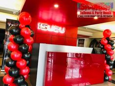 The ALL-NEW Isuzu TRAVIZ at Isuzu Pasig. Balloon Pillars, Balloons, Store, Party, Globes, Storage, Parties, Shop, Hot Air Balloons