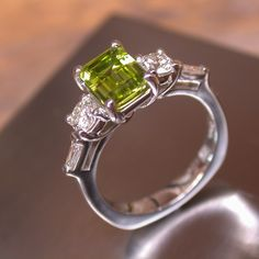 Peridot diamonds and platinum A different engagement ring!
