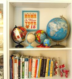 world globe collection-need to find my daughter one! So glad that yard sale/thrift season is coming up!
