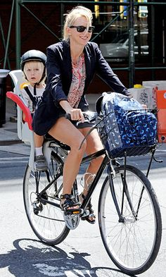 Cool mom. Stylish and trendy, but the most important thing is how she teaches her kid to enjoy biking. Making the best of your parenting. Biking with your kid. All cool kids bike.