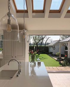Amazing shot from of their beautiful kitchen and garden. The rooflights and the open bifold doors let in so much natural light, perfect on those sunny days! We love the clear glass pendant lighting too! Vaulted Ceiling Lighting, Vaulted Ceiling Kitchen, House Extension Plans, House Extension Design, Extension Ideas, Open Plan Kitchen Dining Living, Open Plan Kitchen Diner, Cosy Kitchen, Glass Kitchen