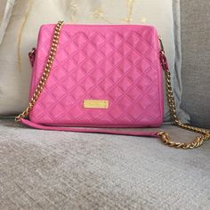 NWT Marc Jacobs quilted leather crossbody bag Brand new Stunning pink quilted lamb leather bag with red canvas interior, removable inner snap red canvas pocket. Gold chain and pink leather strap. Love this bag. This is the higher end Marc Jacobs, not Marc by Marc Jacobs. Marc Jacobs Bags Crossbody Bags