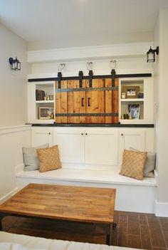 rolling barn doors across a cupboard to hide a TV