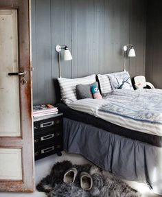 bedroom with wood walls and grays