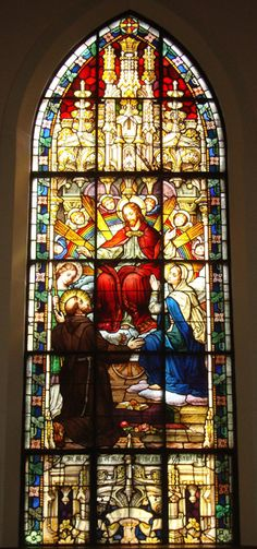 Stained Glass 12 - Depicts a vision that St. Francis had of the Blessed Virgin Mary with heavenly worship and the second coming of Christ.