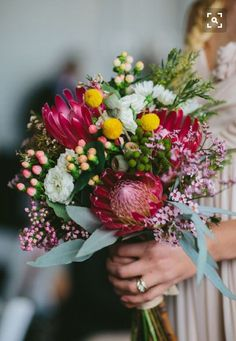 The proteas are a bit dark in colour but beautiful bouquet.