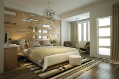 Contemporary bedrooms with dark polished hardwood flooring, large king master bed, light wood wall with insertions of mirrors and a cozy but simple place with a small coffee table and tow chairs.