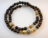 Items similar to Mens Jewelry, Mens Skull Bracelet, Ebony Wood Bracelet, Skull Bracelet, Mens Bracelet, Bracelet for Him, Skulls on Etsy. , via Etsy.
